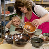 Globe/Roger Nomer<br /> Pamela Praytor helps her granddaughter Annabelle Lucas, 5, select an empty bowl on Thursday at Phoenix Fired Art.