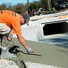 Globe/Roger Nomer<br /> Gabe Lacey works on a drainage ditch on Tuesday at 10th and Peters.