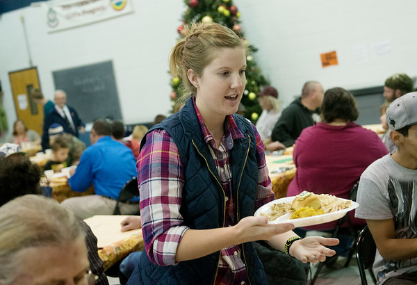 Globe/Roger Nomer<br /> Jordanne Adolphsen, Joplin, serves lunch on Thursday at the Joplin Salvation Army.