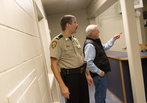 Globe/Roger Nomer<br /> Jasper County Sheriff Randee Kaiser and Jasper County Commissioner Jim Honey look around the new holding facility on Friday at the Jasper County Jail.