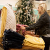 Globe/Roger Nomer<br /> Jade Thompson folds shirts at Sophie on Friday in downtown Joplin.