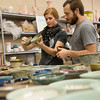 Globe/Roger Nomer<br /> Madeline and Bryan Bridgford examine empty bowls on Thursday at Phoenix Fired Art.