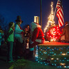 Globe/Roger Nomer<br /> Children line up to talk to Santa beside the water pump on Thursday in La Russell.