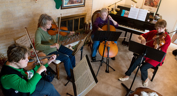 Globe/Roger Nomer<br /> (from left) Roberta Worley, Lucy Gilbert, Ann Davy and Marcia Ball practice a song on Monday afternoon.