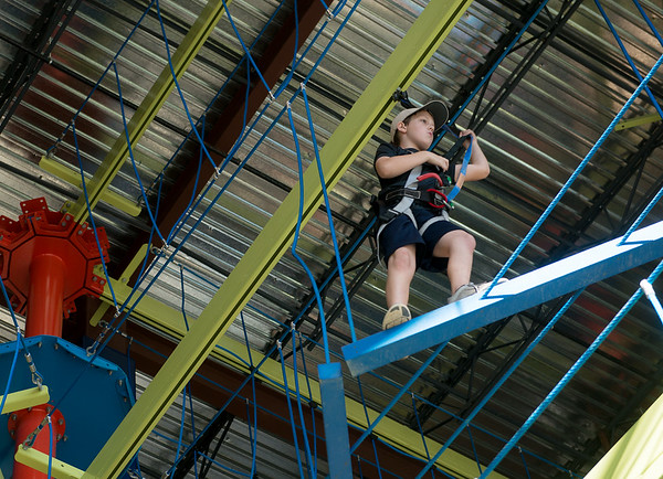 Globe/Roger Nomer<br /> Benjamin Pettigrew, 10, walks through a rope course on Wednesday at Fritz's Adventure.