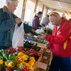 Globe/Roger Nomer<br /> Tim Green sells produce to Frank Nesbitt, Carl Junction, on Saturday at the Webb City Farmer's Market.