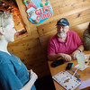 Globe/Roger Nomer<br /> Mackenzie Collins, a senior at Joplin High School, talks with Steve and Sandy Henton, Neosho, on Friday at Texas Roadhouse.
