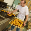 Globe/Roger Nomer<br /> Allen Pendergraft makes donuts on Thursday at Dude's Daylight Donuts.
