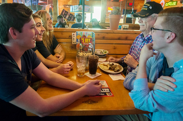 Globe/Roger Nomer<br /> (from left) Will Webster, Joplin High junior, Ashley Butler, sophomore, Caroline Lieurance, junior, Gary Warren, Joplin, and Patrick Claybrook, junior, talk on Friday at Texas Roadhouse.