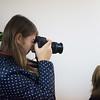 Globe/Roger Nomer<br /> Sofiya Bezpala, a junior at Webb City High School, photographs a magazine writing session on Monday during the Joplin Globe's annual Journalism Workshop.