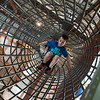 Globe/Roger Nomer<br /> Brody Pettigrew, 6, crawls through a tunnel on Wednesday at Fritz's Adventure.