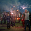 Globe/Roger Nomer<br /> Children wave sparklers as they countdown to lighting the water pump on Thursday in La Russell.