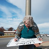 Globe/Roger Nomer<br /> Vicki Walden, Springfield, works on a sign to protest US Bank's funding of the Dakota Access Pipeline on Monday in front of US Bank on Range Line.