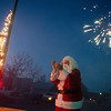 Globe/Roger Nomer<br /> Santa applauds as the water pump in La Russell is lit and fireworks explode on Thursday.