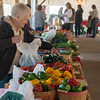Globe/Roger Nomer<br /> Vi Green stock produce on Saturday at the Webb City Farmers Market.