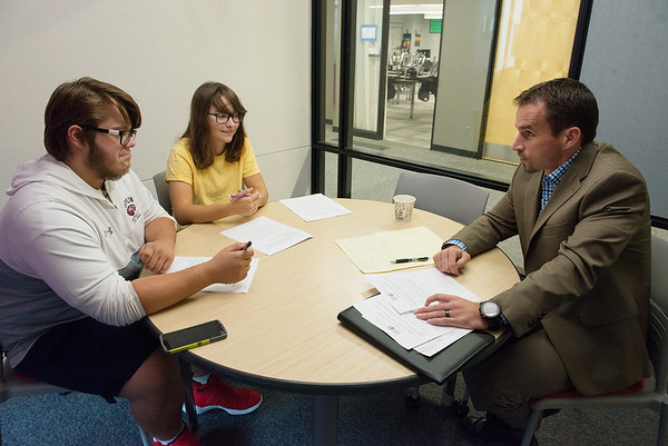 Globe/Roger Nomer<br /> Local attorney Scott Vorhees talks with Joplin High seniors Anna Iorio and Dylan McFarland about their Constitution Team preparation on Monday at Joplin High School.