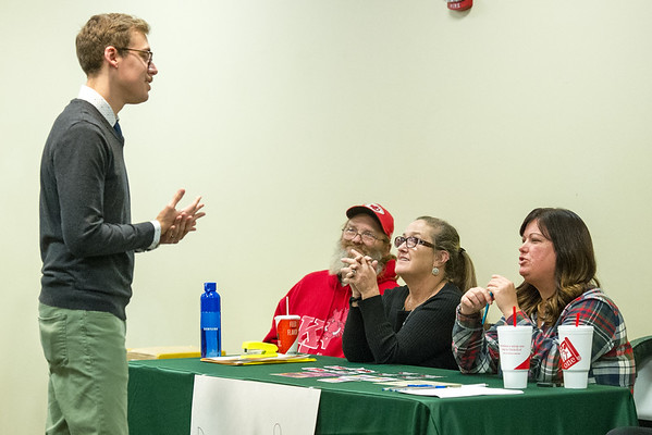 "From the left: Garrett Pekarek chats with volunteers Ray LeGrand, Kelly LeGrand and Amanda Slankard at a donation table benefitting Lafayette House during ""No More,""  an informational expo on domestic violence and sexual assualt on Tuesday night at Missouri Southern. The event was organized by Pekarek as part of a service learning program in his homors sociology class. Pekarek said the goal of the event was to start a dialogue on the issues of domestic violence and sexual assault. <br /> Globe 