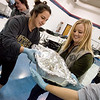 Globe/Roger Nomer<br /> Alice Pedraza, left, Missouri Southern sophomore from Rogers, Ark. and Taylor Erickson, a MSSU junior from Lake of the Ozarks, help prepare turkeys as part of a Zeta Tau Alpha service project at the Joplin Salvation Army on Thursday.