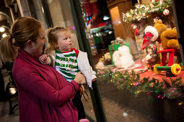 Globe/Roger Nomer<br /> Jamie and Claire, 1, Kelly, Joplin, look at a decorated window on Monday at Joplin City Hall.