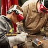 Globe/Roger Nomer<br /> James Raney, McDonald County junior, supervises as Harrison Sliankard, Neosho eighth grader, practices welding on Wednesday at Crowder in Neosho.