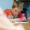 Globe/Roger Nomer<br /> Guner Eads, Mark Twain Elementary third grader, works on a project on bats during class at the Webb City school on Tuesday.