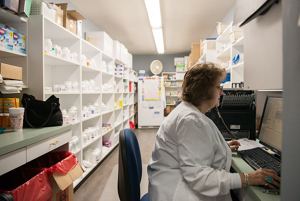 Globe/Roger Nomer<br /> Coco Barry, pharmacy technician, works in the pharmacy of the Joplin Community Clinic on Monday.