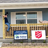 From the left: Eight-year-old Nikolai Diel and his sister, Cynthia Diel, 6, are all smiles as they perch on the porch of their new home at 2129 Wall Avenue before dedication ceremonies on Friday. The house is the 12th built in a partnership between Habitat for Humanity and the Salvation Army.<br /> Globe | Laurie Sisk