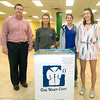 """From the left Omicron Delta Kappa advisor Brian Nichols, ODK Secretary Phaze Roeder, ODK President Kaitlin Fraser and ODK Vice President Grace Scheidemantle stand behind one of 15 collection boxes for the organization's """"One Warm Coat"""" drive on Thursday at Missouri Southern's Billingsley Student Center. Collection boxes were placed inside buildings on campus and off-campus at Victory Life Center and two Southwest Missouri Bank locations. The drive continues through the end of the month with a goal of more than 350 articles of warm clothing to be distributed to Watered Gardens and the Boys and Girls Club of Southwest Missouri .<br /> Globe 