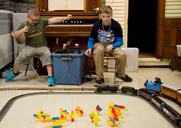 Globe/Roger Nomer<br /> Brian Kooy, 9, Webb City, left, and Luke O'Neal, 11, Carthage, race trains during the Train Show at the Joplin Museum Complex on Saturday afternoon. The Train Show drew exhibitors and visitors from across the region to showcase their train sets.
