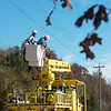 Globe/Roger Nomer<br /> New Mac linemen Ben Mitchell, left, and Brandon Bettels work on lines near Diamond on Wednesday.