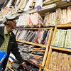 Globe/Roger Nomer<br /> Abdulkadir Abdullahi looks at items at the African Grocery Store in Noel on Friday.