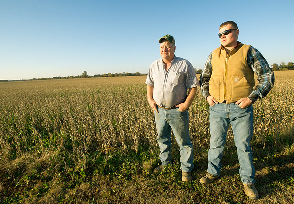 From the left: Liberal farmer Mark Peterson and his son, Christopher Peterson stand in a field on their Liberal farm where Empire District hopes to build a wind turbine.<br /> Globe | Laurie Sisk