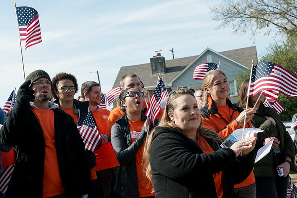Globe/Roger Nomer<br /> Home Depot workers who volunteered on the King's Habitat home cheer on Friday.