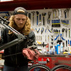 Globe/Roger Nomer<br /> Paris Skaggs, assistant manager and technician at Blues Bike Co., cleans a drive train on Wednesday at the shop.