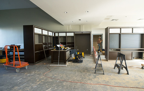 Workers continue construction Wednesday on the lobby of the new Holiday Inn on Range Line.<br /> Globe | Laurie Sisk