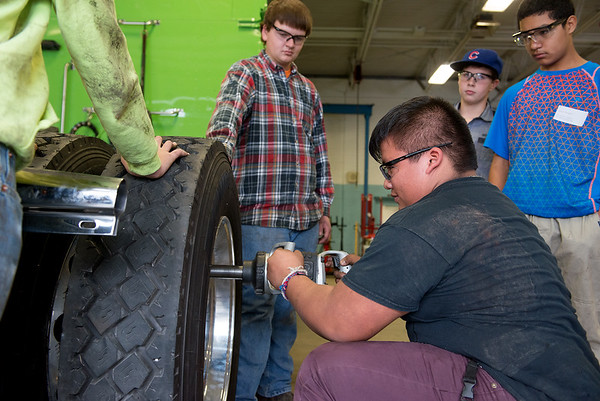 Globe/Roger Nomer<br /> Lazaro Juarez, a Neosho eighth grader, changes a tire on a diesel truck on Wednesday at Crowder in Neosho.