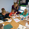 Globe/Roger Nomer<br /> Sarah Greek helps her third graders with a project on bat during class on Tuesday at Mark Twain Elementary in Webb City.