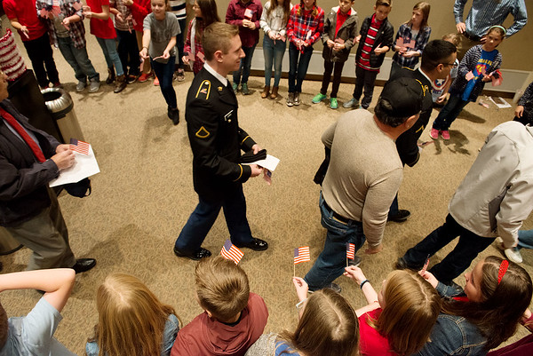 Globe/Roger Nomer<br /> College Heights Christian School students recognize veterans following Thursday's ceremony at the school.