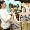 Sophie owner Ashley Wakefield places shopping bags on a rack Wednesday in preparation for Small Business Saturday at her downtown store.<br /> Globe | Laurie Sisk