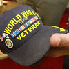 A Purple Heart and POW pin, along with others, sit attached to Keith Fiscus' World War II cap. Fiscus will be serving as Grand Marshall for the Veterans Day Parade in downtown Joplin today.<br /> Globe | Laurie Sisk