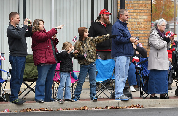 Spectators watch as parade entries make their way down Main Street during the Veterans Day Parade on Saturday in downtown Jolin.<br /> Globe | Laurie Sisk
