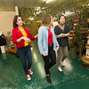 From the left: Pittsburg State Circle K adviser Amanda Minton directs Circle K volunteers Ailee Story and Emily Vue on Thursday at the museum. <br /> Globe | Laurie SIsk