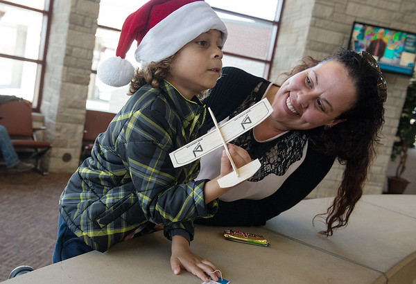 Globe/Roger Nomer<br /> Dedan Busch, 4, Joplin, plays with his glider as he looks for his aunt to board at Joplin Regional Airport with his mother Danielle on Thursday.
