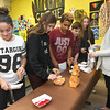From the left: Yulianna Barajas, 12, Sam Jasinski, 12, Tevon Reed, 12, Caden Peters, 11 and Mackenzie Koler, 12, make candy cornucopias as Craft Lab Coordinator Sierra Buckland assists on Wednesday at the Boys and Girls Club of Southwest Missouri. The activity was part of the club's afterschool program.<br /> Globe | Laurie Sisk