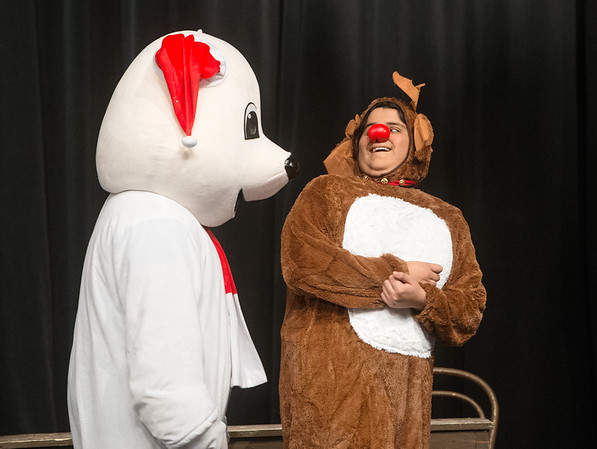 "Globe/Roger Nomer<br /> Tristan Lett, Joplin High junior, as a polar bear, and Angel Hernandez, sophomore, as Rudolph, perform a scene during a rehearsal of ""Crazy Cocoa Christmas"" at Joplin High School on Thursday."