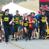 Runners leave the starting line during the Run with the Heroes 5K on Saturday at Missouri Southern. The event kicked off a week full of veteran-related events, which will conclude Friday with a Veterans Day ceremony open to the public at 11:3o a.m. on the Oval.<br /> Globe  Laurie Sisk