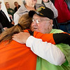 Globe/Roger Nomer<br /> New homeowner Ronald King gets a hug from Ellen Quinn, services supervisor for the Home Depot in Harrison, Ark., after Friday's Habitat for Humanity ceremony.