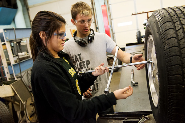 Globe/Roger Nomer<br /> Aaron Craven, Seneca High junior, helps Erika Ornelas, Neosho eighth grader, with changing a tire on Wednesday at Crowder in Neosho.