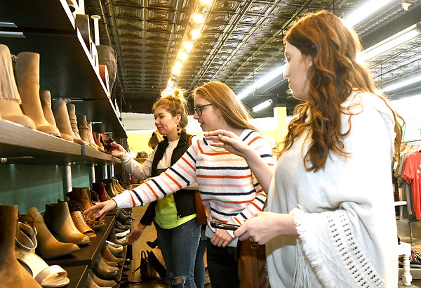 From the left: From the left: Emmy, Elexa and Ellie Dagnan engage in some sisterly shopping on Wednesday at Sophie. Downtown shop owners are busy preparing for Small Business Saturday.<br /> Globe | Laurie Sisk