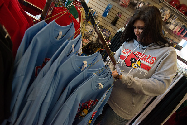 Globe/Roger Nomer<br /> Krystal McCoy, embroidery specialist at The Dugout, looks through Webb City shirts at The Dugout on Thursday.